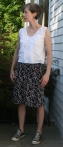 Rooster print cotton skirt underlined with silk crepe with striped top made from shirting cotton.