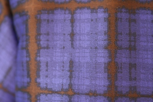 Closeup of fabric.  It is a jacquard weave, as well as a plaid.  Swoon.