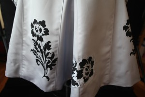 an appliqued flower next to one that's printed onto the coat fabric.