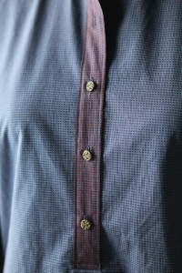 Closeup of placket with the metal buttons.