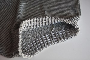 elastic threaded through the ribbing at the waist.