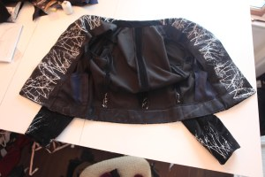 the inside is unlined. I did a Hong Kong finish on the seams.  The facings and lapels are silk satin.