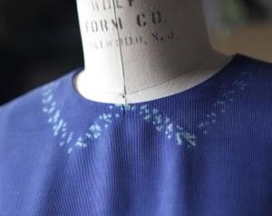 Shibori dyed trompe l'oeil collar detail.