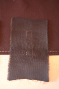 Take a rectangle of contrast fabric.  Stitch it to the front along the stitching lines.