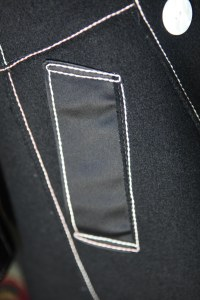 welt pocket.  The welt itself in silk satin