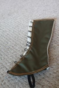 I made the button loops out of elastic cord.  You can also see the elastic that goes around my shoe to keep the spat on.