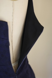 black silk lining on the bodice.  The skirt is unlined.