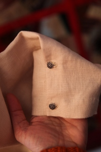 sleeves are hemmed, folded over, and buttoned.  No cuff.