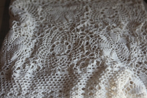 the crochet lace tablecloth that I cut up and dyed for the trim.  I bought it at an estate sale.  It's a pretty standard item that lots of old people have.