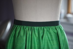 I gathered the skirt into a grosgrain ribbon waistband. There is a side zip.